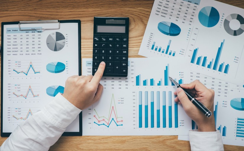 Businessman,Working,On,A,Graph,Document,Financial,Report,And,Analysis