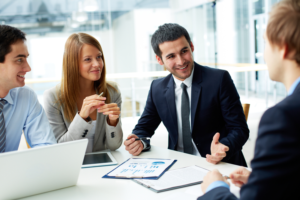 Image,Of,Business,Partners,Discussing,Documents,And,Ideas,At,Meeting