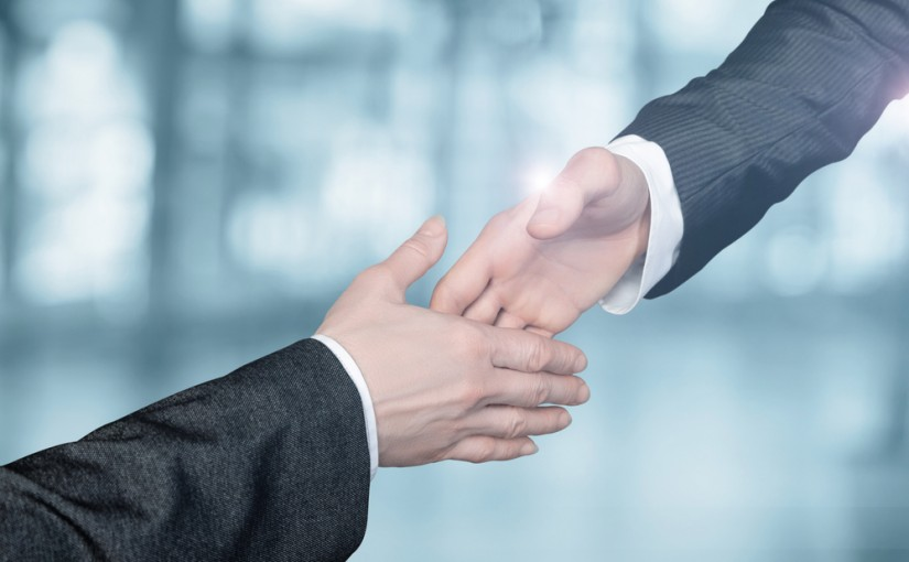 Businessmen,Reach,Out,To,Each,Other,To,Shake,Hands,On