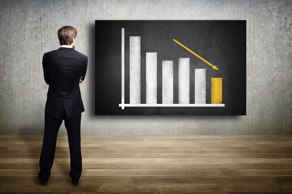 Businessman,Looking,At,A,Diagram,Showing,A,Declining,Graph