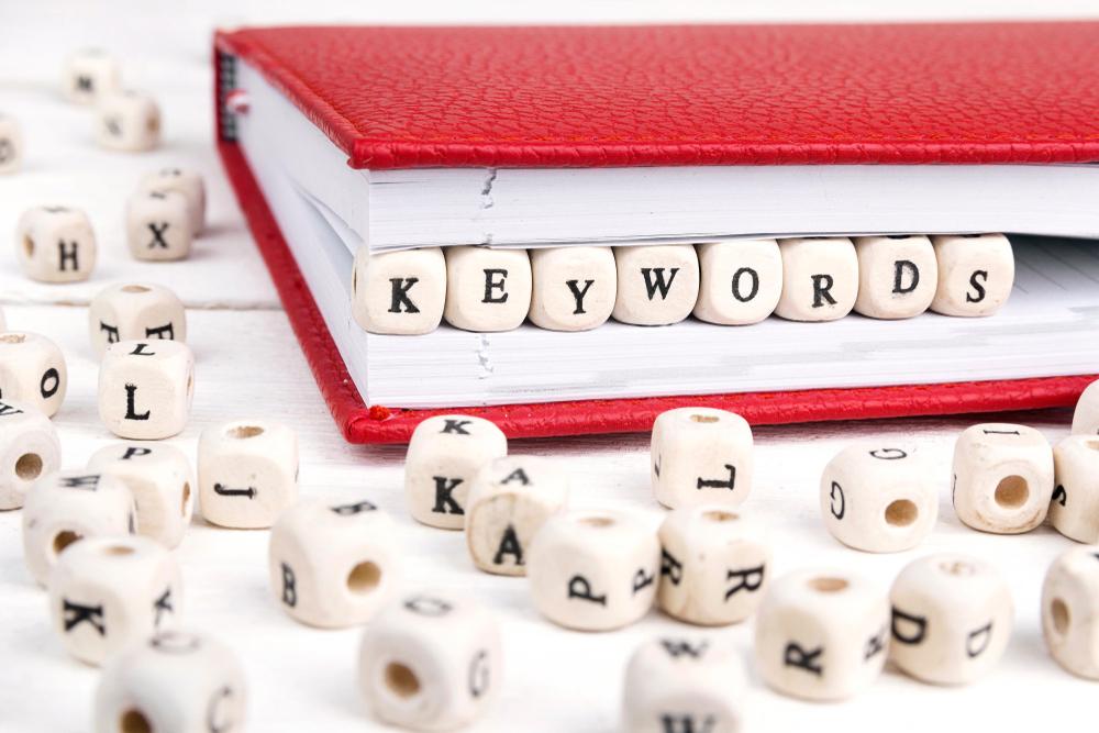 Word,Keywords,Written,In,Wooden,Blocks,In,Red,Notebook,On