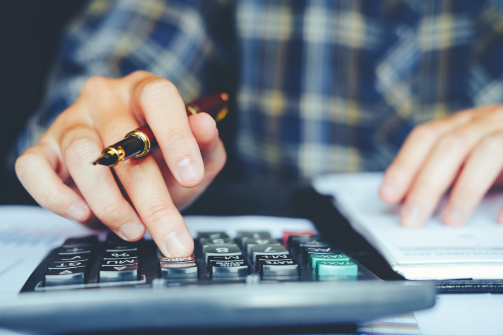 Businessman's,Hands,With,Calculator,At,The,Office,And,Financial,Data