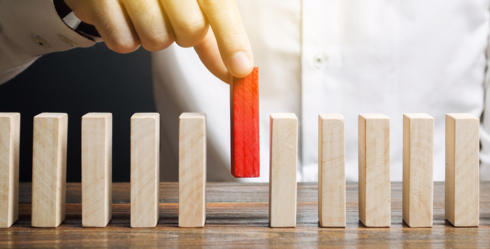 Businessman,Holds,A,Wooden,Block,In,His,Hands.,The,Concept