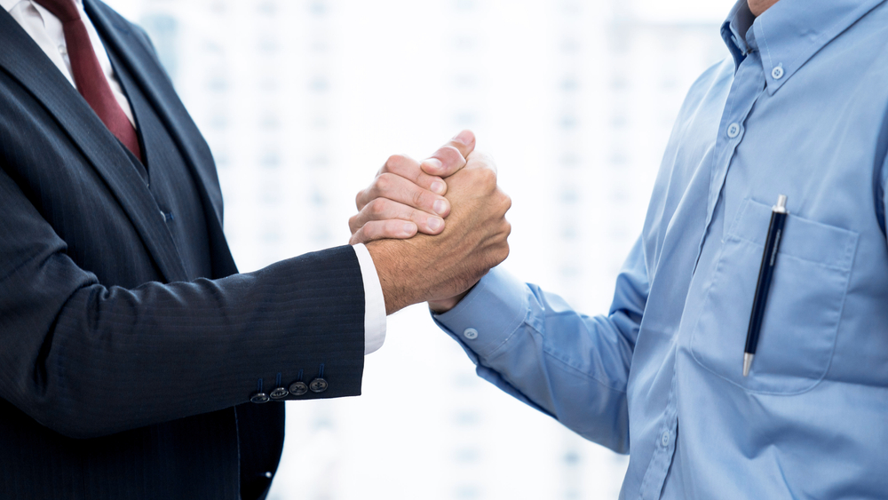 Business,People,Shake,Hands,When,Reaching,A,Business,Agreement,Together.
