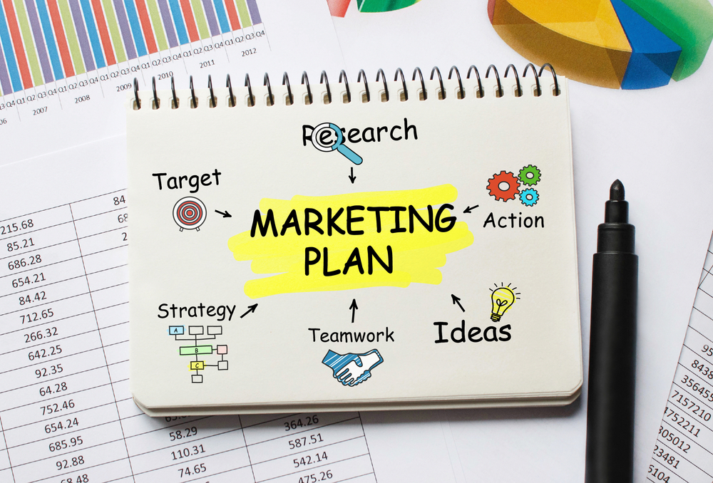 Notebook,With,Toolls,And,Notes,About,Marketing,Plan