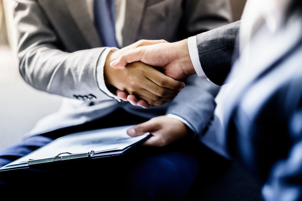 Businessman,Shaking,Hands,To,Seal,A,Deal,With,His,Partner
