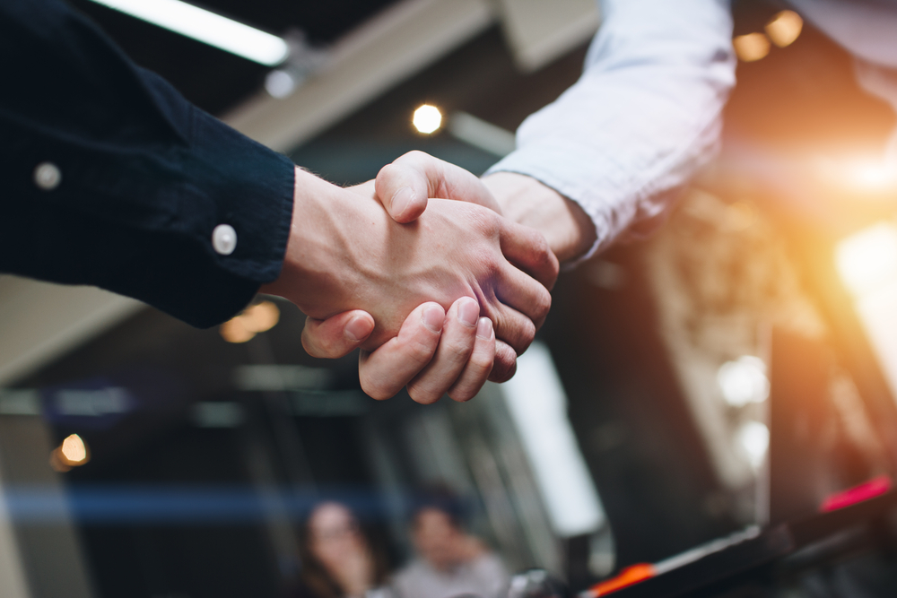 Bussines,Partners,Handshakes,In,Modern,Open,Space,On,The,Background